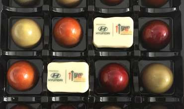 Chocolates in brand colours